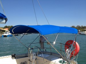 Dave's Trimmers Bimini suspended on storntion rail